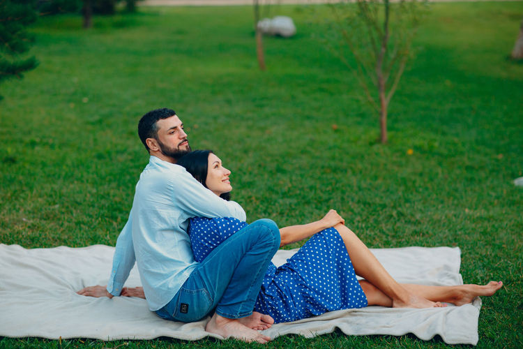 Side view of couple kissing on land
