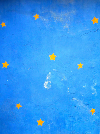 Blue painted wall with yellow stars ArchiTexture Backgrounds Blue Concrete Wall Copy Space Dream Illustration Painted Plaster Sky Stars Textured  Textures And Surfaces Wall Yellow Star