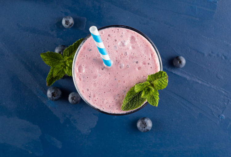 Blueberry smoothie overhead shot Bluberry Blueberry Smoothie Food And Drink Healthy Smoothie Mint Garnish Mint Leaf - Culinary Overhead Smoothie Topdown