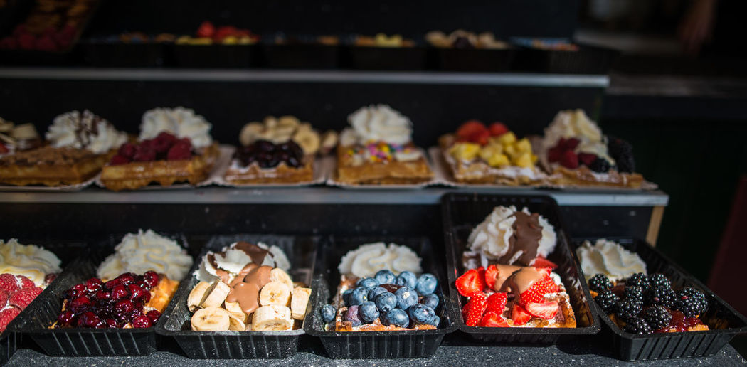 Waffles with fruit and whipped cream Abundance Arrangement Choice Collection Display Food For Sale Freshness In A Row Indulgence Large Group Of Objects Market Market Stall No People Ready-to-eat Repetition Retail  Sale Shelf Shop Side By Side Small Business Still Life Store Variation