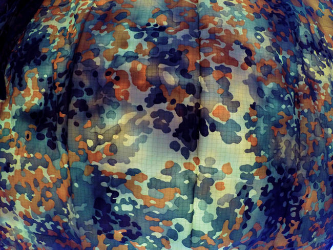 "this is a shot of a poncho/shelter I bought at a military surplus store many years ago. it's a flecktarn or ""fleck"" camouflage pattern. this poncho goes with me everywhere in my pack. countless outdoor concerts as a ground cover, bikes races as a sun and wind shelter, quite a few bike rides as rain poncho. versatile durable, I love this thing. you snap other ponchos together with it and make a tent. Pattern Pieces Patterns & Textures Military Surplus Fashion Style Drab Camouflage Camo Blending In  Pattern Whatever"