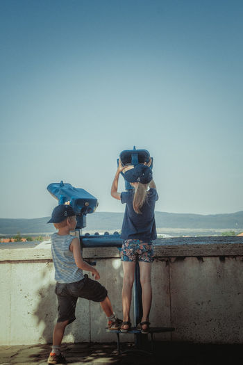 Two children looking at view