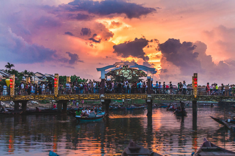 An amazing sunset in Hoian, Vietnam ASIA Colors Colour Your Horizn Hoi An Travel Travel Photography Vietnam Clouds And Sky People River Sunset Travel Destinations