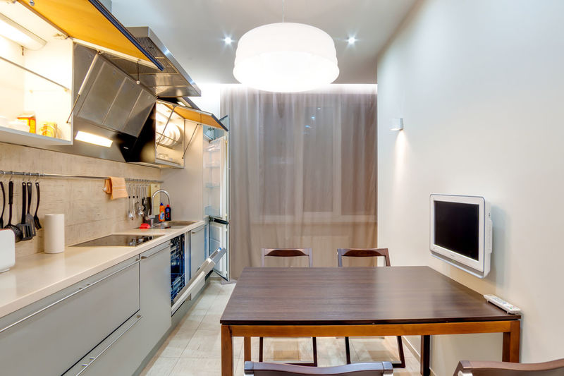 Home Kitchen Domestic Kitchen Domestic Room Indoors  Home Interior Appliance Household Equipment Modern Home Showcase Interior No People Table Lighting Equipment Seat Absence Kitchen Counter Furniture Architecture Lifestyles Sink Luxury Electric Lamp Steel