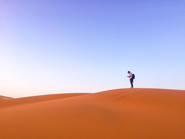 camera with hatena Sand Dune Sand Clear Sky One Person Copy Space Nature Scenics Sunlight Blue Day Beauty In Nature Sky Trip Aroundtheworld Viajar Memories Beauty In Nature Morocco Sahara Desert Merzouga