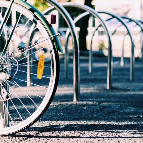 Cropped Image Of Bicycle Parked At Bicycle Rack