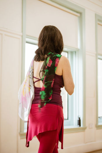Nia Rear View One Person Indoors  Women Standing Real People Three Quarter Length Adult Lifestyles Fashion Clothing Dress Home Interior Leisure Activity Focus On Foreground Hairstyle Day Casual Clothing Hair