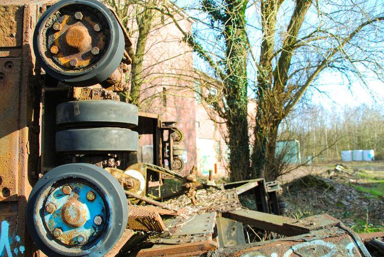 Old abandoned vintage car on land
