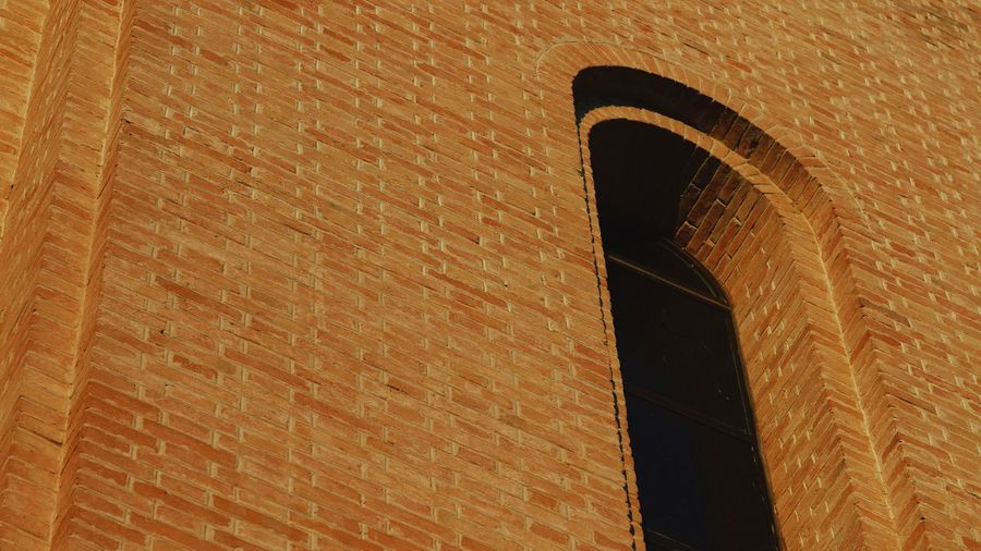 EyeEm Selects Built Structure Architecture No People Arch Wall - Building Feature Building Exterior Day Wall Low Angle View Outdoors Pattern Sunlight Brown Textured  Full Frame Close-up
