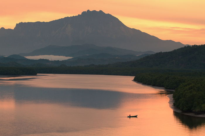 Beautiful morning scenery at Mengkabong river, Kota Kinabalu, Sabah with a background of mount Kinabalu, the highest mountain in South East Asia Adventure Amazing View Beauty In Nature Boat Calm Day Evening Fisherman Mengkabong River Morning Mountain Nature Outdoors Paradise Peaceful Scenics Sky Sunrise Sunset Tranquil Scene Tranquility Tree Tua Water The Great Outdoors - 2017 EyeEm Awards