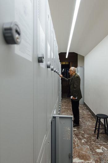 Man Standing In Locker Room