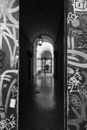 Dietro i murales Murales Artistic Cityscape Inspirational Shadows & Lights High Angle View Italy Secret Places Canon5Dmk3 EyeEmBestPics EyeEm Best Edits Blackandwhite Camouflage Moments Architecture_collection Architecture Built Structure Arch Building Building Exterior No People Day Art And Craft Graffiti Entrance Corridor Creativity Outdoors Mural Ornate