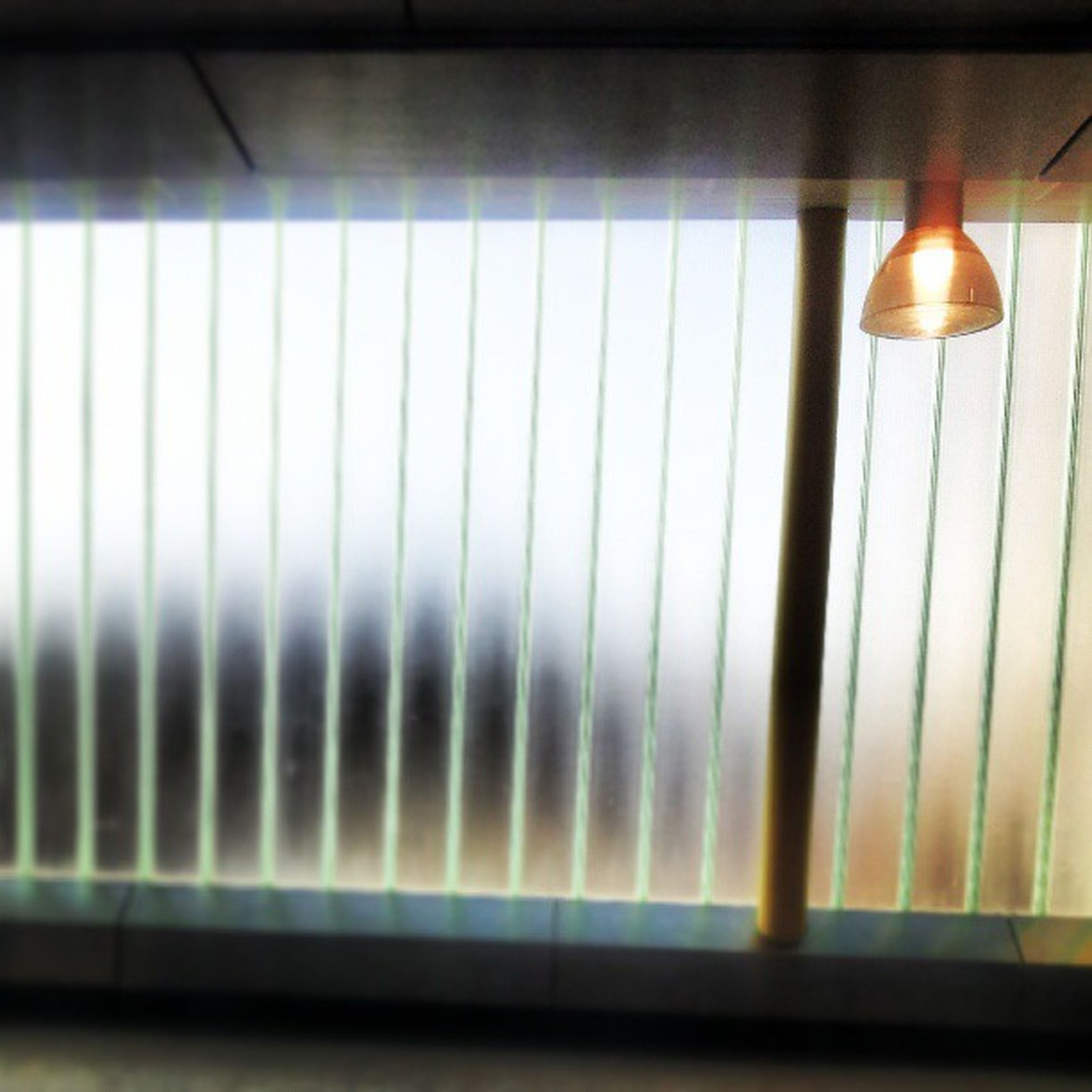 indoors, window, home interior, illuminated, glass - material, transparent, reflection, pattern, close-up, no people, lighting equipment, wall - building feature, blinds, absence, shadow, empty, domestic room, table, curtain, wall