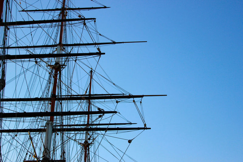 Wooden ship mast, parallel lines in the sky Blue Boat Bowsprit Clear Sky Close-up Day Harbor Horizontal Low Angle View Marine Mast Nautical Vessel Navigation No People Outdoors Parallel Rope Sailboat Sailing Ship Ship Shipping  Transportation Vessel Wooden