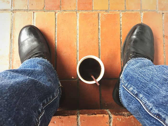 Coffee time Low Section Human Leg Shoe Jeans Personal Perspective Body Part Human Body Part Real People Casual Clothing High Angle View Lifestyles Leisure Activity Day One Person Standing Men Human Foot Outdoors Directly Above Unrecognizable Person Capture Tomorrow