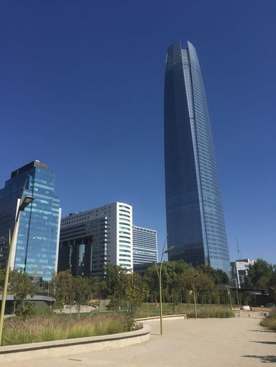 Architecture Blue Building Exterior Built Structure Chile City Cityscape Clear Sky Costanera Center Day Gran Torre Modern No People Office Park Outdoors Sky Skyscraper Travel Travel Destinations Tree