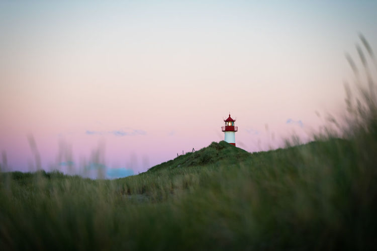 Lighthouse on sylt island germany during colorful cloudless sunset no. 1