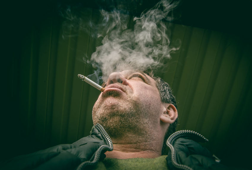 Addiction Bad Habit Cigar Cigarette  Close-up Danger Indoors  Leisure Activity One Person People Real People RISK Smoke - Physical Structure Smoking - Activity Smoking Issues Social Issues Studio Shot Young Adult