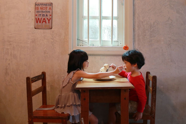Happiness is not a destination, it is a way Boy Brother & Sister Child Childhood Girl Happiness Ice Cream Indoors  Love People ShareTheMeal Sitting Table Togetherness Two People Waffle Time Window Finding New Frontiers Food Stories