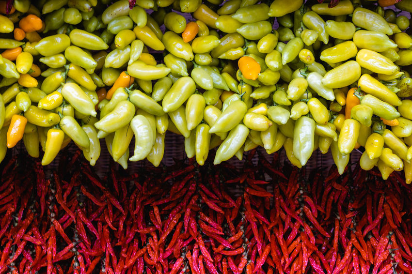 Food And Drink Food Vegetable Freshness Chili Pepper Abundance Large Group Of Objects Pepper Spice Wellbeing Healthy Eating Full Frame Market Retail  For Sale Green Color No People Green Chili Pepper Still Life High Angle View Red Chili Pepper