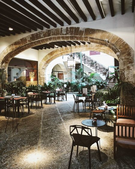Palma de Mallorca, Spain Mediterranean  Arch Architecture Business Cafe Cafeteria Chair Day Empty Furniture Indoors  Interior Design Restaurant Seat Spanish Resturant Table