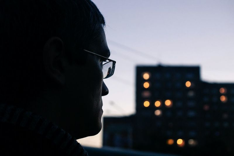 Side view of thoughtful mid adult man at dusk