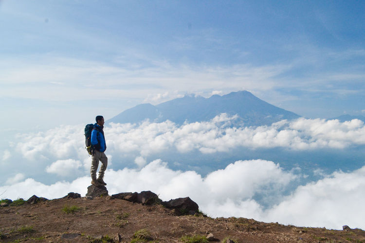 Sky Mountain One Person Cloud - Sky Beauty In Nature Standing Scenics - Nature Leisure Activity Day Full Length Tranquil Scene Tranquility Non-urban Scene Nature Holiday Vacations Environment Mountain Range Adventure Trip Outdoors Looking At View Mountain Peak