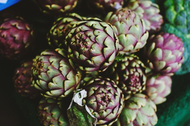 Close-up of artichokes in container