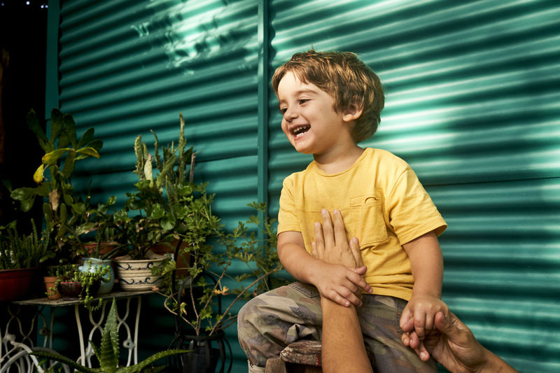 Portrait of happy boy outdoors