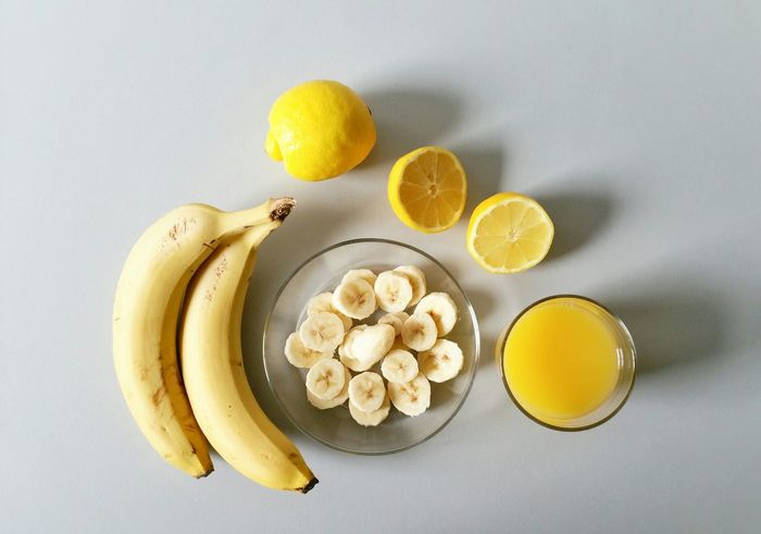 It was one of those march days when the sun shines hot and the wind blows cold, when it's summer in the light and winter in the shade. (Charles Dickens) Yellow Fruit Healthy Lifestyle Vegeterian Bananas Lemon Fresh Juice Smoothie White Background At The Table Drink In The Kitchen No People Vertical Shot Full Frame Kick Start Better Together Smart Simplicity Food Fruits Colors Minimalism Spring Eye4photography  EyeEm Best Shots