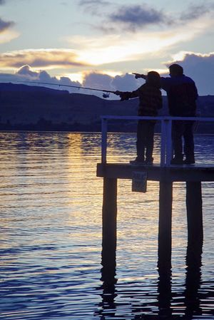 Fishing Fishing Pole Two People Water Silhouette Lake Nature Beauty In Nature Sky Rear View Sunset Reflection Scenics Lake Taupo Cloud - Sky Full Length Real People Togetherness Standing Tranquil Scene Men Outdoors Leisure Activity