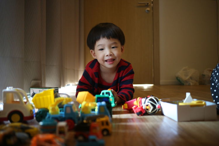 Portrait Of Cute Boy Playing At Home