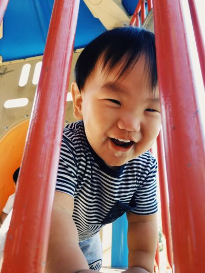 Portrait of cute boy playing in playground