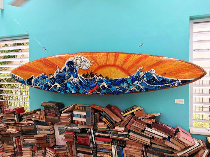 Artistic Upgrade of a surfboard Animal Representation Art And Craft Blue Book Built Structure Creativity Day Exhibition Multi Colored Nature No People Publication Sun Surfboard Surfboard Art Wall - Building Feature Wave Pattern Wood - Material