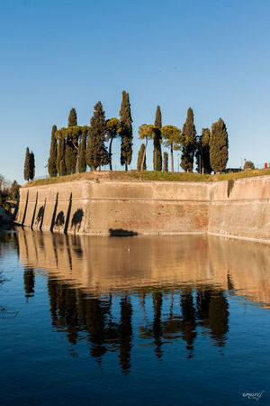 Riflessi Reflection Water History Architecture Tree No People Lake Built Structure Travel Destinations Sky Day Outdoors PeschieraDelGarda Canon_photos Landscape Clear Sky Garda Lake Italy The Week Of Eyeem Peschiera Del Garda EyeEm Gallery Garda Lake Lago Di Garda Canonphotography Canon_official Blue