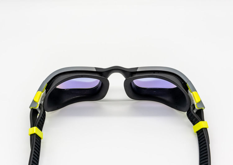 Close-up of sunglasses against white background