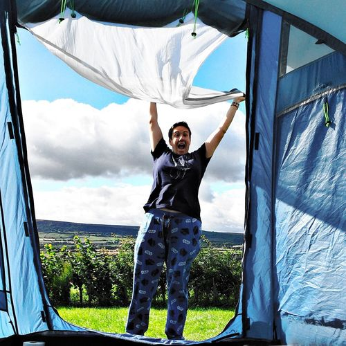 Happy to wake up in a tent! Camping Tent Arms Raised Sky Day Happiness Leisure Activity One Person Front View Looking At Camera Real People Smiling Outdoors Lifestyles Full Length Cheerful Portrait Young Adult Nature Grass Love Yourself