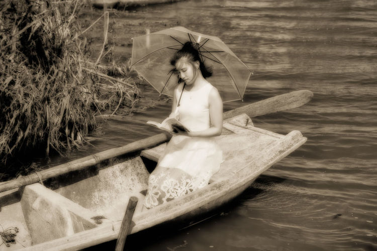 My Secret Resort! Boat Book Girl Gloomy Muddy Observing A Scene Paddel Peaceful Personal Peace Reading Reed Romantic Rudder Seclusion Sitting Outside Tranquil Scene Umbrella Water White Dress Young Women Sophie Wu Woman Who Inspire You Retro Style Vintage