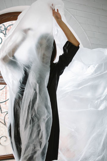 Woman Wrapped In Plastic At Home