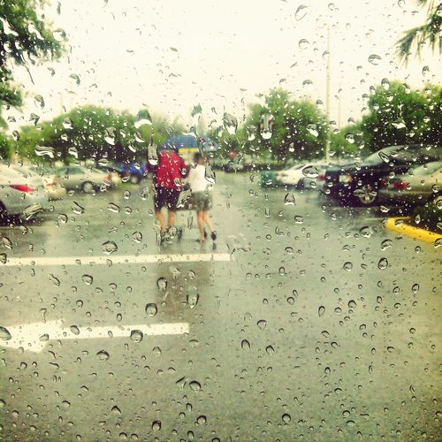 watching man run to car, get wet, get umbrella and come get his wife from store so she can be dry :) <3 Enjoying Life Taking Photos Check This Out rainy day, true love, sharing umbrella, good husband,