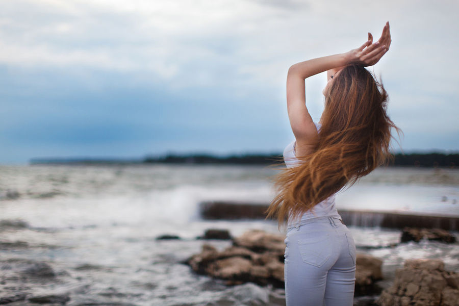 Summer feelings, Croatia Beach Beauty In Nature Blue Sky Bluehour Freedom Freshness Girl Long Hair Model Nature One Person Only Women Outdoors People Sea Sexygirl Summer Sunset Water Women Young Adult