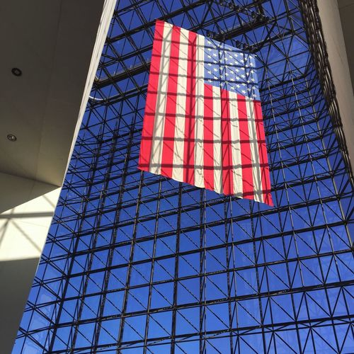 Patriotism Low Angle View Red Architecture Flag Modern Day Window Indoors  Blue Politics And Government Sky No People Built Structure