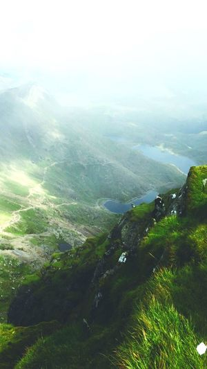 A Bird's Eye View on top of Mount Snowden. Tranquil Scene Scenics Landscape Mountain Tranquility Non-urban Scene Beauty In Nature Fog Nature Idyllic Mountain Range Aerial View Water Remote Foggy Tourism Day Outdoors Sky Cloud - Sky