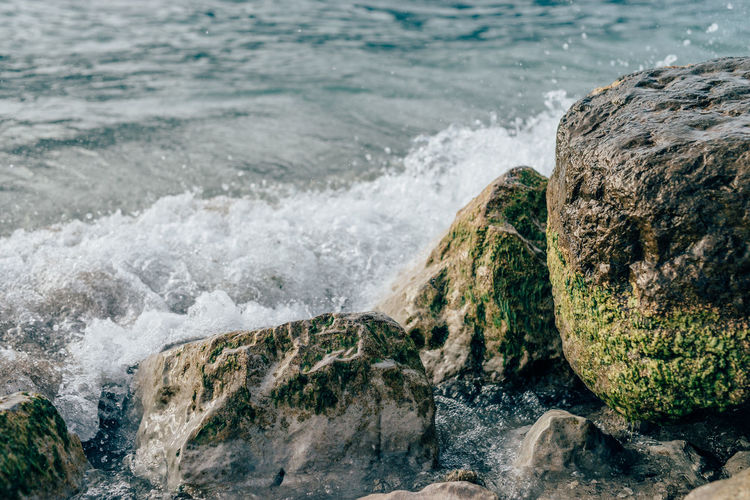 Natural Relaxing Wet Stones Beauty In Nature Day Foamy Waves Nature No People Outdoors Rock - Object Scenics Sea Spume Water Wave Waves Waves Crashing On Rocks Wet