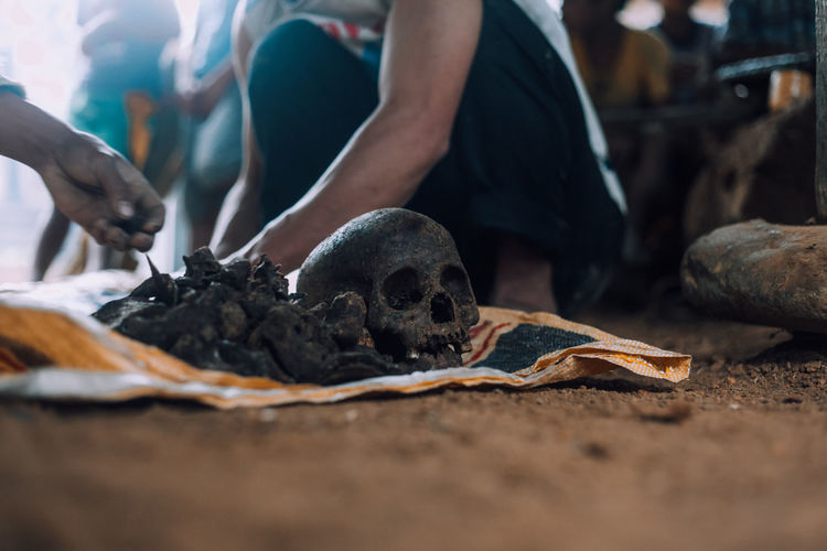 Reburying a set of human remains as a tradition in the mountains of the philippines. low angle shot