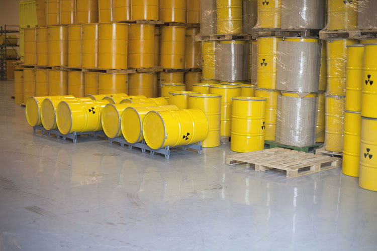 A warehouse with radioactive waste disposal barrels Nuclear Disposal Radioactive Barrel Danger Disaster Environment Hazard In A Row No People Nuclear Nuclear Energy Nuclear Power Plant Nuclear Waste Radiation Radioactive Barrels Radioactive Waste Symbol Threat Toxic Warehouse Warning Sign Waste Waste Disposal Waste Management Yellow Color
