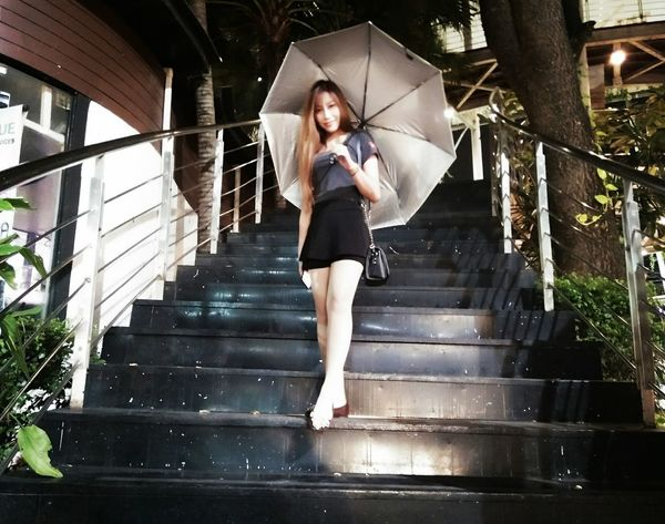 Rainy season Only Women One Woman Only Young Adult Adult One Young Woman Only Adults Only One Person Full Length Young Women People Jumping Staircase Steps Steps And Staircases Front View Long Hair Beautiful Woman Women Beauty Beautiful People