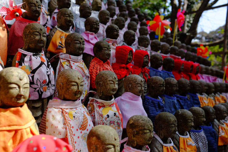 "Dozens of small stone Buddha statues sit in perfect rows, one above the other, outside this hilltop temple in rural Japan, each dressed in cloaks by worshippers. The temple was used as the filming location for the Tom Cruise movie, ""The Last Samurai."" Buddhist Colourful Engyoji Temple Japan Japanese Culture Arrangement Brightly Coloured Buddhist Temple Close-up Hyogo Multi Colored No People Outdoor Rows Sacred Statue Temple Temple Grounds Variation"