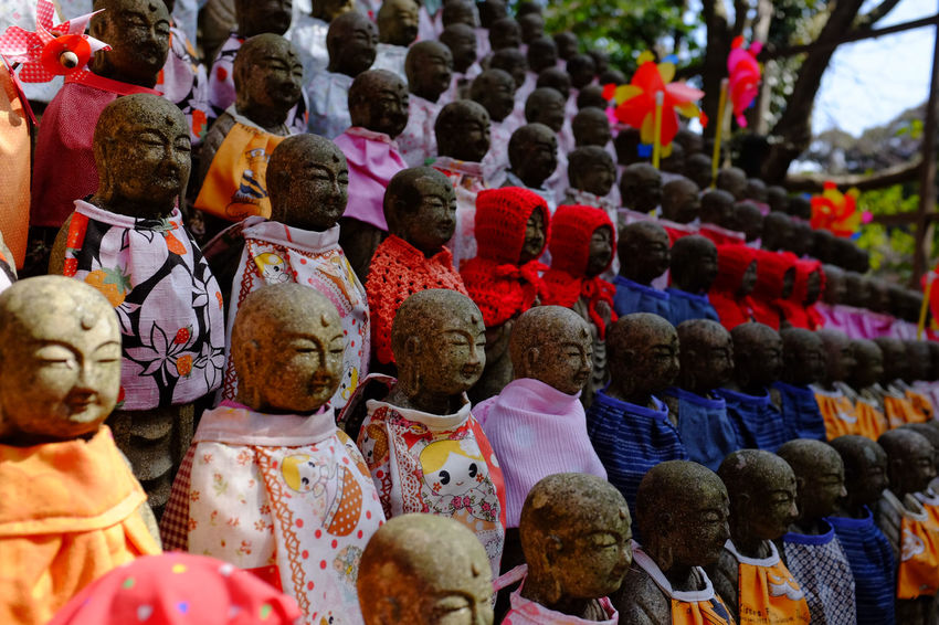 """Dozens of small stone Buddha statues sit in perfect rows, one above the other, outside this hilltop temple in rural Japan, each dressed in cloaks by worshippers. The temple was used as the filming location for the Tom Cruise movie, """"The Last Samurai."""" Buddhist Colourful Engyoji Temple Japan Japanese Culture Arrangement Brightly Coloured Buddhist Temple Close-up Hyogo Multi Colored No People Outdoor Rows Sacred Statue Temple Temple Grounds Variation"""