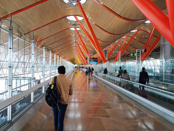 Walking Real People Transportation Men Rear View Architecture Motion Women Indoors  Day One Person Adults Only Sky People Adult Airport Runaway Barajas T4 Adolfo Suárez Madrid-Barajas Airport